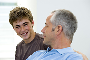 Smiling teenager with parent
